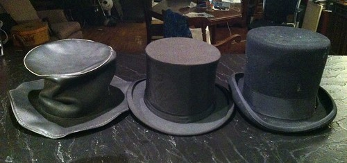 Three top hats (Left to right: leather, vintage collapsible silk, wool felt).