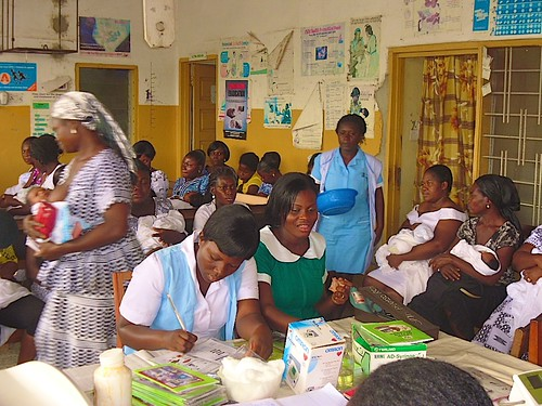 Nurses doing paperwork at the Post Natal Clinic of St Michael's Hospital, Pramso, Ghana