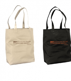 Two tote bags stand on a white background. Tote on the left is cream colored with a chocolate imprint that says bitch: it's a noun. it's a verb. it's a feminist media organization. Tote on the right is black with a tomato imprint that says the same thing.