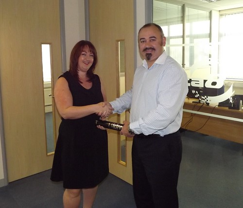 Bernie McCool receives her award from Antony Allen