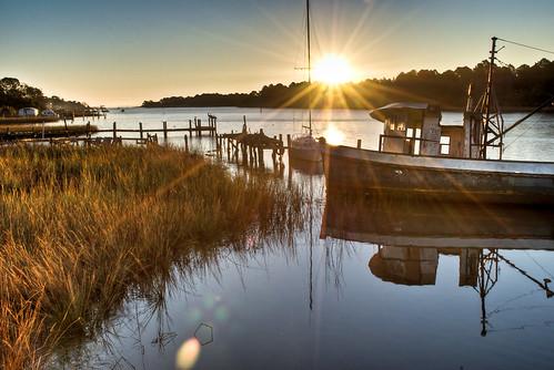 morning usa pelicans water docks sunrise reflections boats dawn early fishing unitedstates florida south sparkle southern grasses marsh ripples sunrays eastpoint apalachicola gulfcoast apalachicolabay theforgottencoast floridapanhandle