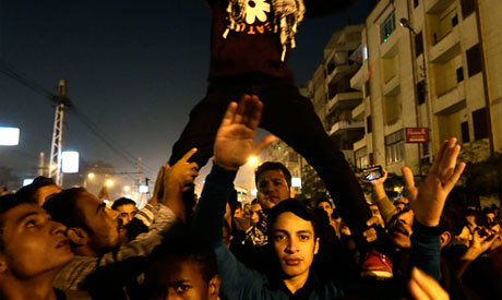 Egyptian anti-government protesters in Cairo say they are moving toward the presidential palace on December 6, 2012. The demonstrations have escalated every day against President Morsi. by Pan-African News Wire File Photos