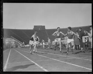 Harvard vs. Holy Cross relay race at Harvard Stadium