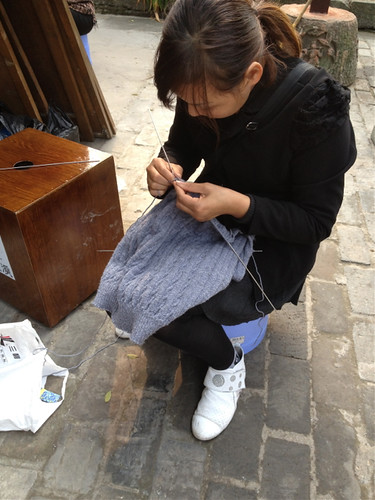 Chinese woman knitting 1
