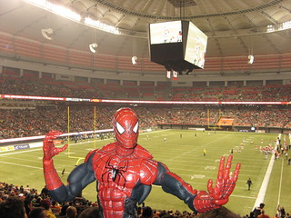 Spider-Man throws an imaginary football at BC Place