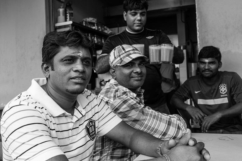 These migrant workers were out enjoying breakfast on a Sunday morning. I sat down among them and photographed them. Try doing that in any other coffeeshop elsewhere in Singapore....