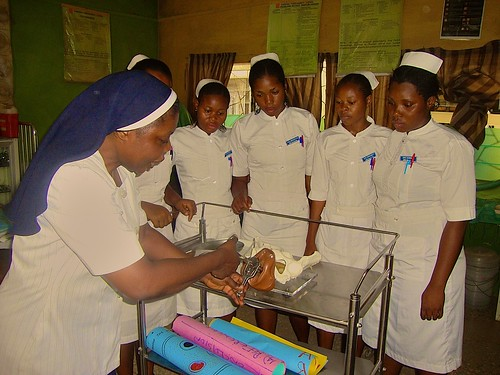 Christiana Adeforiti SSL teaching a practical class to the students of St Louis School of Midwifery, Zonkwa, Kaduna State, Nigeria