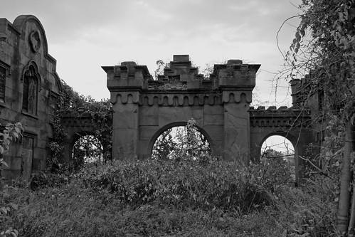 back of abandoned gate house bw by mujetdebois