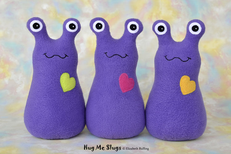 Slugterra and purple fleece Hug Me Slugs, original stuffed animal art toy by Elizabeth Ruffing