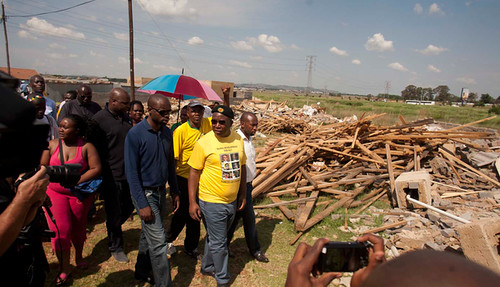 Former ANC Youth League president Julius Malema tours the razed housing settlement at Lenasia. The plight of the residents was his concern during the visit. by Pan-African News Wire File Photos