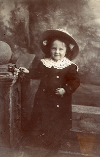 Smiling child in a large hat