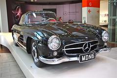 automobile(1.0), automotive exterior(1.0), vehicle(1.0), performance car(1.0), automotive design(1.0), mercedes-benz(1.0), auto show(1.0), mercedes-benz 190sl(1.0), mercedes-benz 300sl(1.0), antique car(1.0), vintage car(1.0), land vehicle(1.0), luxury vehicle(1.0), sports car(1.0),