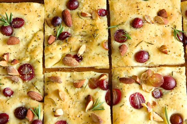 roasted almond focaccia bread with grapes and rosemary