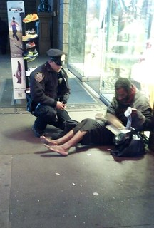 NYC Police Officer Buys Boots for Homeless Man