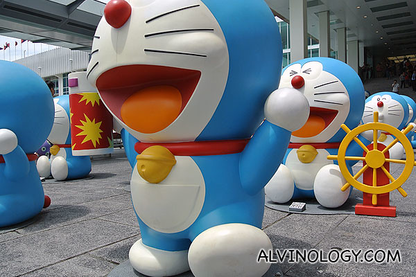 Doraemon with a spray can and a sailing one behind