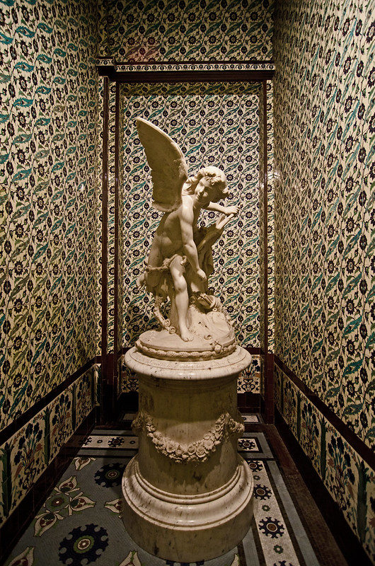 A nook full of tile and sculpture at the Wallace Collection