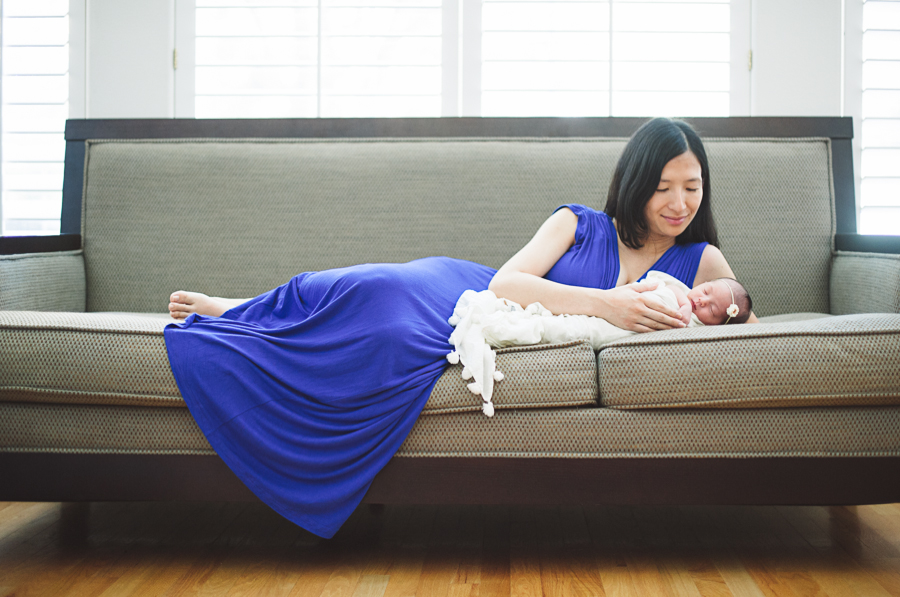 mommy and newborn baby on sofa in home newborn photos in dallas