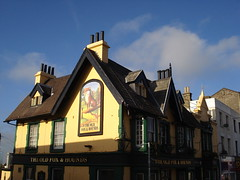 Side view of the same pub as above, showing the gable wall with a large painting of a fox on it.