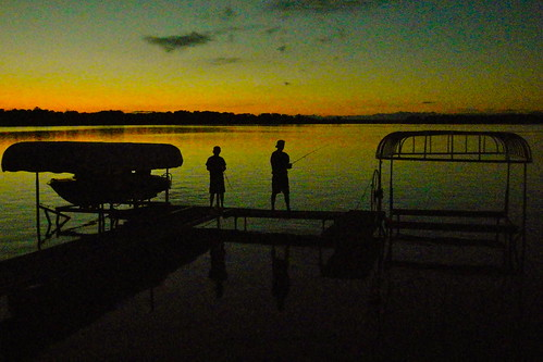 sunset lake alexandria minnesota fishing cabin silhouettes grainy iphone iphonephotography