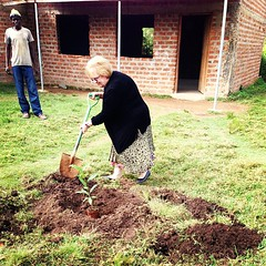 Jeanne Williams planting a tree in the school courtyard #KenyaRelief2012