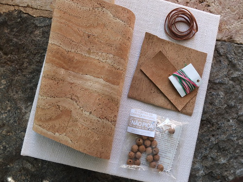 Supplies to make a book cover made of cork fabric