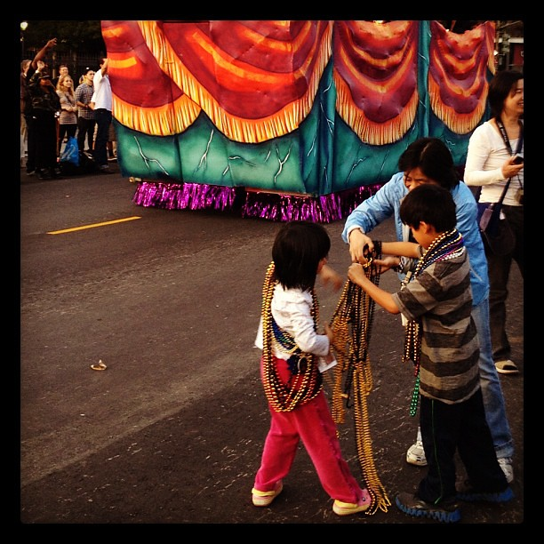 Kids in a bead frenzy at the New Orleans Thanksgiving parade