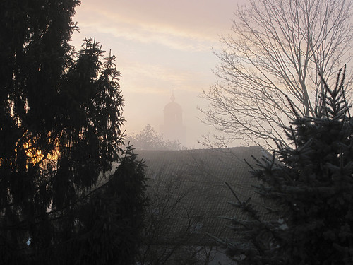 Lebuines church looming through the mist