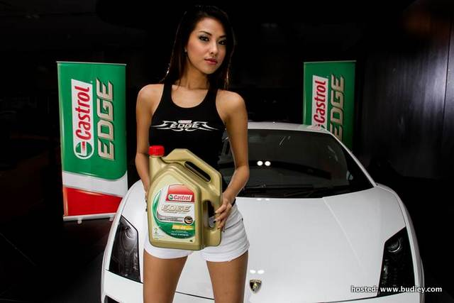 Castrol brand ambbasador posing with Castrol's strongest and most advanced performance oil - Castrol EDGE.