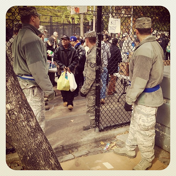 New Yorker getting food in #AlphabetCity surrounded by National Guard. #sandy