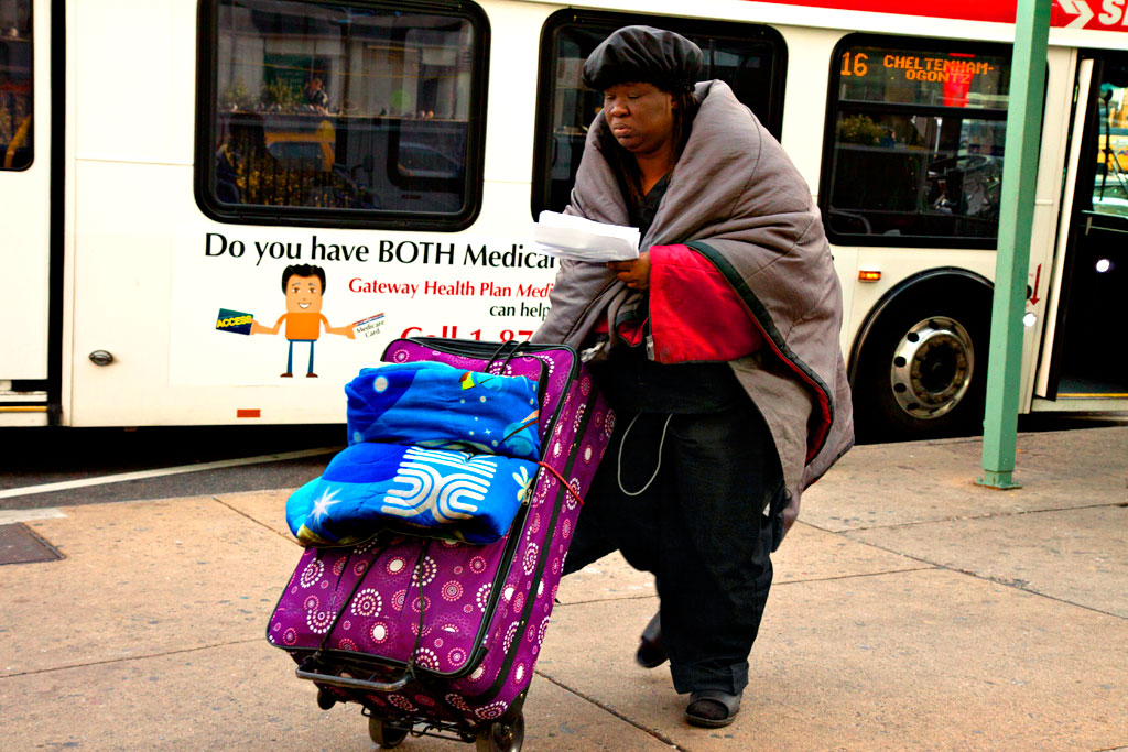 Homeless-woman-pushing-large-suitcase-on-11-16-12--Center-City