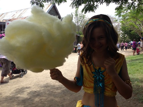 Girl with fairy floss at markets