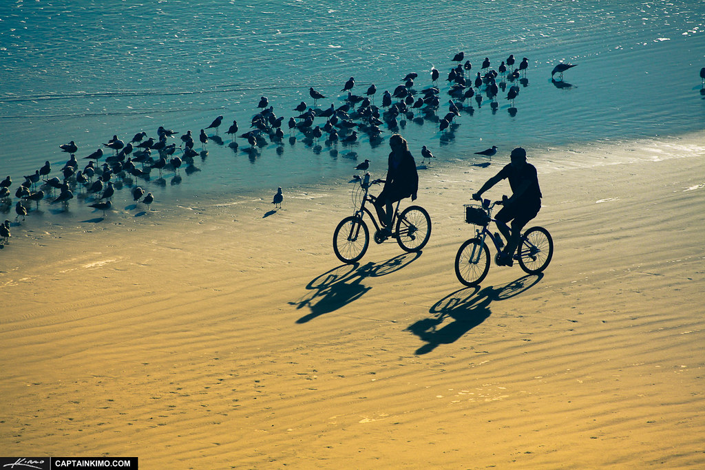 Couples-at-Daytona-Riding-Bicycle-on-Beach