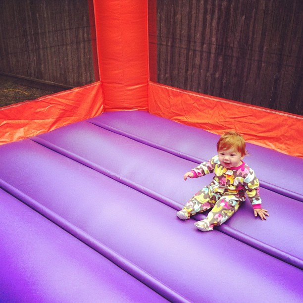 Before the guests arrived, Lucy got to play in the bouncehouse all by herself and love it