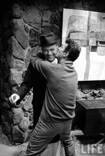 Dean Martin laying a smooch on Frank Sinatra, 1965.
