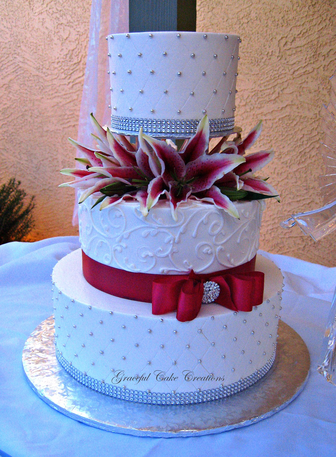 Elegant White Buttercream Wedding Cake with Silver and Red