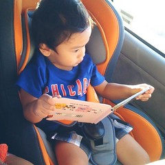 Reading to himself.