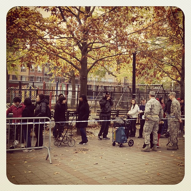 Man taking photo of his son with National Guard on Saturday - #aphabetcity #sandy #nyc