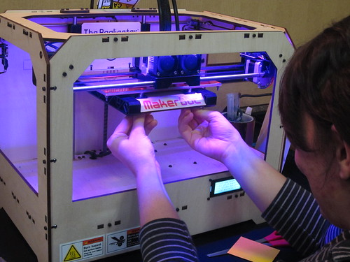 Maria Kramer, a Teen Librarian calibrating her super-cool Makerbot 3D printer