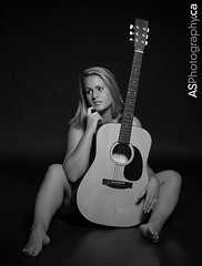 Stunning blonde woman with a guitar