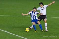 australian rules football(0.0), soccer-specific stadium(0.0), women's football(0.0), football player(1.0), ball(1.0), sport venue(1.0), soccer kick(1.0), kick(1.0), sports(1.0), team sport(1.0), tackle(1.0), player(1.0), football(1.0), ball game(1.0), stadium(1.0), ball(1.0),