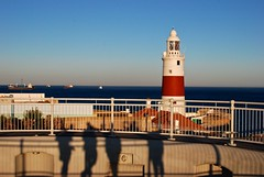shadows, lighthouse, ships.