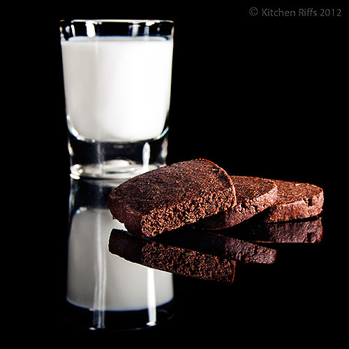 Chocolate Pepper Cookies with Milk on Black Acrylic