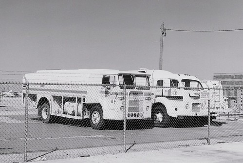 Vintage White jet fuel tanker trucks at Chicago's Midway Airport.  Chicago Illinois.  April 1990. by Eddie from Chicago