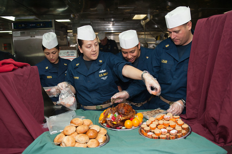 Sailors prepare a postponed Thanksgiving meal