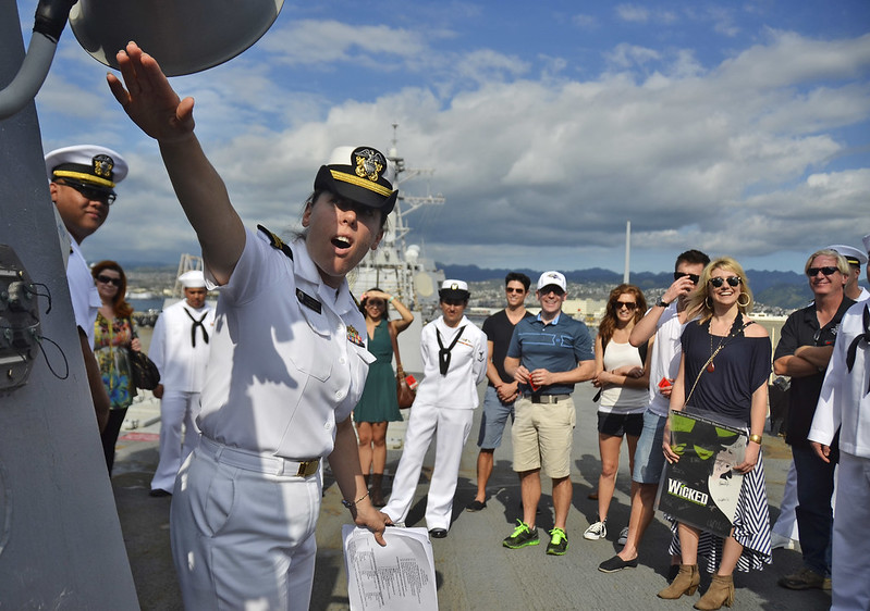 "Lt. j.g. Jami M. Talbott provides a tour of the ship to cast members of the touring Broadway musical ""Wicked""."