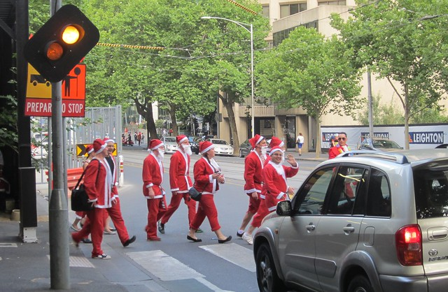 Santas crossing the street