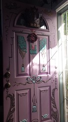 Hand painted artistic front door, bows, wreath, metal decor, crown, angels, tassles, jewel, fruit, summer sun, pinkie - purple, Broadview, Seattle, Washington, USA