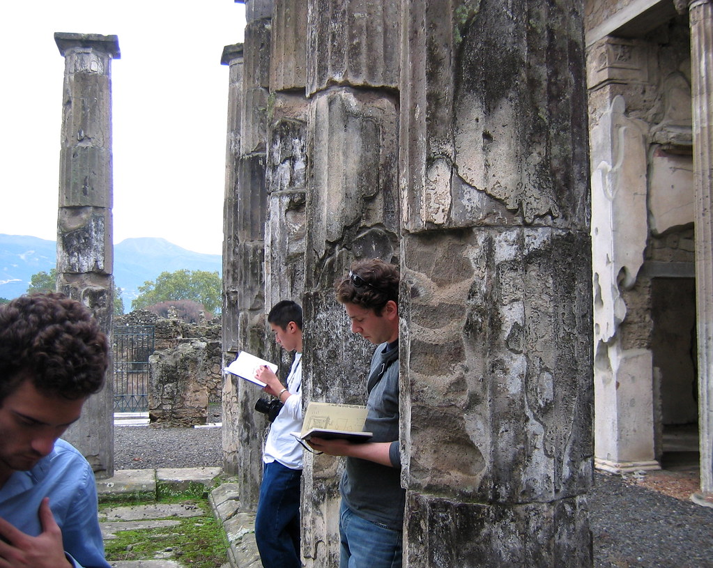Architecture students Adam Greene and Albert Lin sketching in Pompei, fall 2004.  photo / Troy Rog-Urman (B.Arch. '06)
