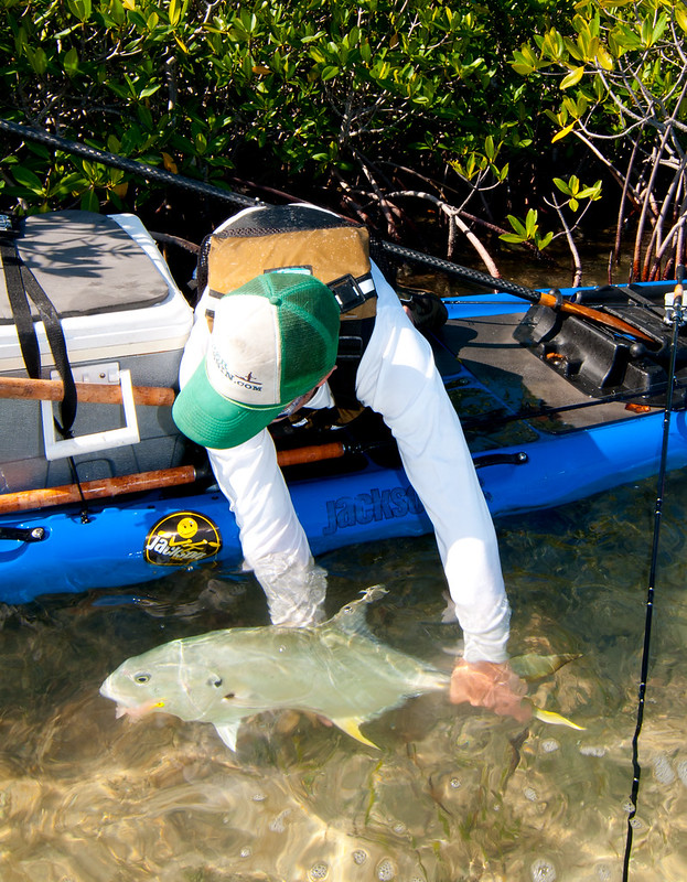 Drew Gregory releasing the Jack he landed on the Jackson Kayak SUPerFISHal