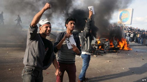 Egyptians clash in Alexandria prior to the December 15 vote on the national referendeum for the draft constitution. Both opponents and supporters of the draft are battling it out in the streets. by Pan-African News Wire File Photos